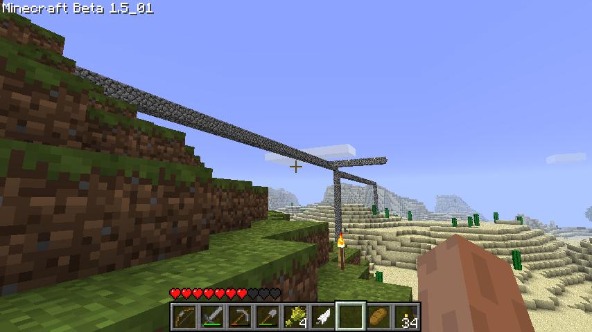線路用橋(建設中)と隣の砂山と溶岩&水オブジェ